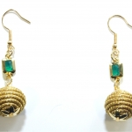 golden grass earrings with orb and emerald